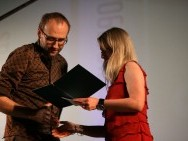 Marcin Koszałka receiving People's Choice Award
